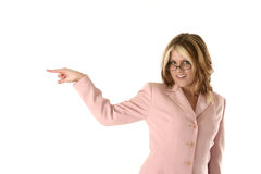Point Left. Female salesperson, pointing to the left and smiling royalty free stock photos