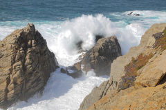 Point Lobos Surf. The rocky shoreline of Point Lobos State Natural Reserve on the central California coast provides a dramatic view of the surf crashing on its Royalty Free Stock Image