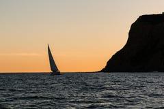 Point Loma Peninsula with Nearby Sailboat at Dusk Stock Photo
