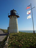 Point Montara Lighthouse. View of Point Montara Lighthouse with United States and California flags stock photos