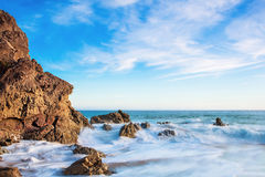 Point Mugu. A long exposure of waves crashing into the rocky shoreline at Point Mugu, State Beach in Malibu, CAlifornia stock images