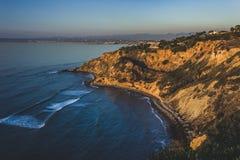Point plat de roche au coucher du soleil Photos stock