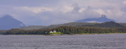 Point Retreat Lighthouse. Rests on the northernmost extension of Admiralty Isand and separates Lynn Canal from Favorite Channel, a part of the inside passage in Stock Images