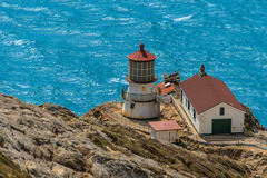 Point Reyes lighthouse on cliff by Pacific Ocean Stock Photo