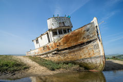 Point Reyes Shipwreck. Old boat wrecked on the sand along Point Reyes, California royalty free stock photos