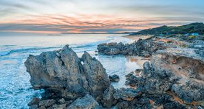 Point Ritchie lookout and beautiful rocks at dusk. Aerial panorama of rocks at Point Ritchie lookout at dusk. Warrnambool, Victoria, Australia royalty free stock photography