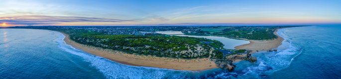 Point Ritchie lookout and Hopkins River mouth at sunset. Wide aerial panorama of Point Ritchie lookout and Hopkins River mouth at sunset. Warrnambool, Australia stock photography