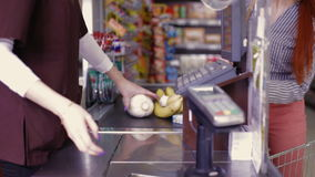 Point of sale.Cashier scans purchase products