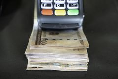 Point of Sale Machine with Nigerian Naira notes. Point of Sale Machine with Nigerian Naira bank notes royalty free stock photo