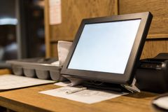 Point of sale POS touchscreen terminal. Tablet for waiter to make and send orders. Cafe administrator table with mobi