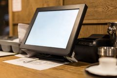 Point of sale POS touchscreen terminal. Tablet for waiter to make and send orders. Cafe administrator table with mobile printer stock photo