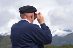 Point and Shoot. Tourist taking photo from cruise ship in Alaska Stock Image