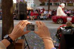 Point And Shoot Camera Captures Moments From Christmas Parade. Atlanta, GA, USA - December 1, 2012:   A woman's hands hold a point and shoot camera as she Royalty Free Stock Photos