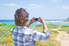 Point and shoot: girl using camera. stock photos