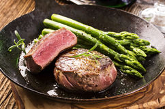 Point Steak with Green Asparagus stock photos