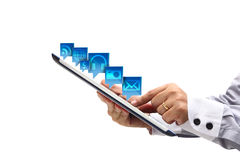 Point on Tablet PC with cloud of application icons Royalty Free Stock Photos