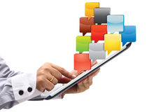 Point on Tablet PC with cloud of application icons Royalty Free Stock Photo