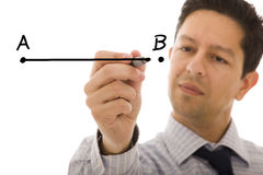 From point A to B. Businessman drawing a line from point A to point B (selective focus royalty free stock photos