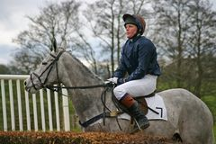 Point to point. Lady on grey looking at the first jump Royalty Free Stock Images