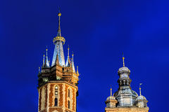 Point of towers of st. Marys church in krakow main square at nig Stock Photos