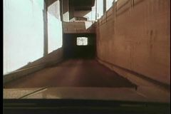 Point of view of car driving through tunnel stock footage