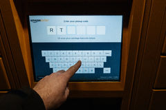 Point of view of customer looking at the Amazon Locker digital touchscreen stock photo