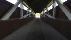 A point of view drive through a Covered Bridge stock video footage