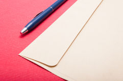 Point of view of envelop and pen on office table Stock Image