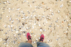 Point of view of feet on a beach Royalty Free Stock Images