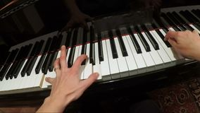 Hands of woman playing slow music on piano  FDV stock footage