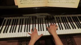 Hands of woman playing slow music on piano  FDV stock video