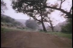 Point of view from motorcycle speeding on dirt road stock footage