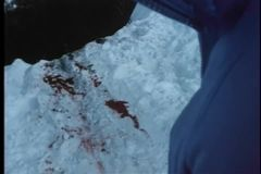 Point of view shot of bloodstains on a snowy cliff stock video