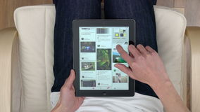 Point of view shot of browsing Pinterest pins on an iPad stock video