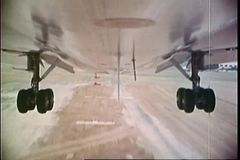 Point of view shot of undercarriage of an airplane landing on runway