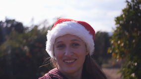 Point-of-view shot of woman in Christmas hat spinning around in the garden. Point-of-view shot of young woman in Christmas hat spinning around in the orange stock video footage
