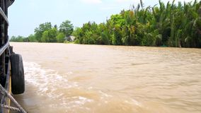 Point of view from the side of a traditional Vietnamese boat sailing on the Mekong River, Vietnam stock video