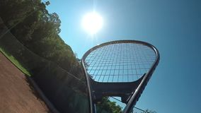 Point of view slow motion with hand of tennis player holding racket and serving at tennis court in a summer day. POV point of view slow motion with hand of stock video