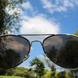 Point of view. Sunglasses shot with a shallow depth of field Royalty Free Stock Image