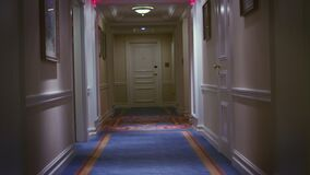 Point of view walking on long corridor in luxury hotel or luxury mansion. Point of view walking on long corridor in luxury hotel. View point person walking along stock footage