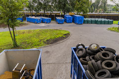 Point of waste segregation. Central point of waste segregation in Krakow , Poland View of containers with old furniture and tires stock images
