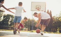 Point that will decide the win. Family playing basketball royalty free stock photo