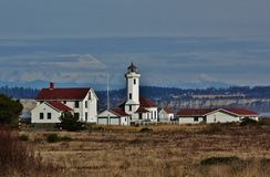 Point Wilson Lighthouse. With Mt Baker in background Royalty Free Stock Photography