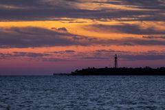 Point Ybel Light at Daybreak - Sanibel Island. Gorgeous colors fill the sky at daybreak silhouetting the Point Ybel Light, a metal lighthouse on Sanibel Island stock image