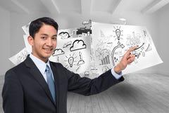 Pointage asiatique de sourire d'homme d'affaires Photo stock