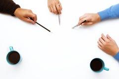 Pointage blanc d'espace de travail et de mains Images libres de droits