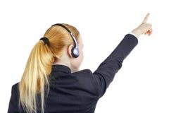 Pointage de femme d'opérateur Photographie stock libre de droits