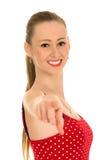 Pointage de jeune femme Image libre de droits