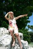 Pointage de jeune fille Images stock