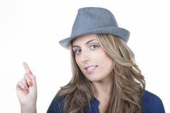 Pointage de sourire de femme Photographie stock libre de droits